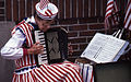 Woman playing accordion, 1987 July 4, Faneuil Hall Marketplace (8657140427).jpg