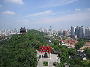 Yellow Crane Tower - View to the east from the Yellow Crane Tower. Snake Hill is in the middle and the red-brick compound of the Wuchang Uprising memorial is to the right