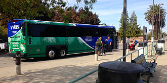 Amtrak Thruway Motorcoach - Passengers boarding a YARTS bus at the Merced, California station operating as Amtrak California Thruway Motorcoach route 15 to Yosemite.