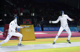 Fencing at the 2004 Summer Olympics - Russian Igor Turchin and American Weston Kelsey duel in the second round of the Olympic men's individual épée event at the Hellinikon Fencing Hall on 17 August 2004