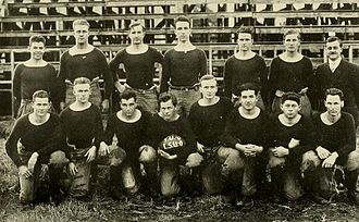 1914 Tulane Olive and Blue football team - The 1914 team with a football painted to celebrate their tie with LSU
