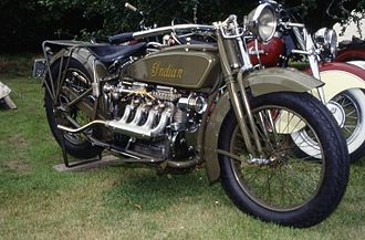 Ace Motor Corporation - 1928 Indian Ace, with leading-link forks and a large central coil spring. Later Indian Fours would feature Indian-style trailing-link forks with leaf springs.