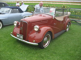 Touring car - An Australian built 1948 Ford Anglia A54A Tourer with hood down and side curtains attached. The belt line in the front door is lowered.