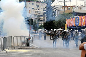 English: Greek riot police - using tear gas, A...