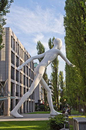 Munich Re - Walking Man by Jonathan Borofsky in front of the business premises on Munich's Leopoldstraße