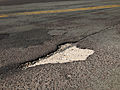2014-08-29 15 29 36 Patch of concrete showing through the asphalt overlay on Lower Ferry Road (Mercer County Route 643) at Stuyvesant Avenue in Ewing, New Jersey.JPG