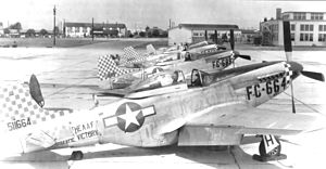 "Shaw Air Force Base -  20th Fighter Group P-51D Mustangs parked at Shaw Field, November 1946.  Serials identified are serials: 45-11665, 45-11689, and 44-84855.   Note the postwar ""buzz number"" on the fuselage along with the AAF Wartime fuselage marking and checkered wartime paint at the cowling and tail."