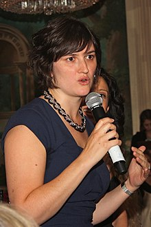 Sandra Fluke speaks into a microphone