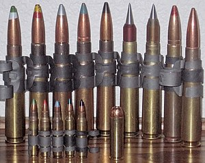 .50 BMG - Left to right, rear: Mk211, Spotter, Silver tip (Armor Piercing Incendiary), Blue tip (Incendiary), Black tip (Armor Piercing), SLAP-T, SLAP, Tracer, and Ball. Front row are 5.56×45mm NATO and .500 S&W Magnum for size comparison