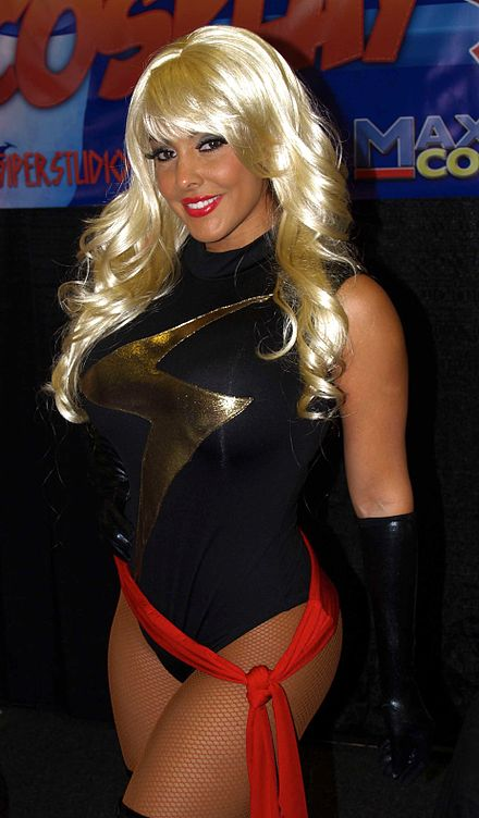 Nina Mercedez cosplaying as Ms. Marvel at the 2013 Wizard World New York Experience Comic Con 6.28.13NinaMercedezByLuigiNovi2.jpg