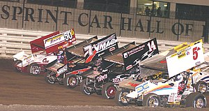 Sprint car racing - World of Outlaws drivers make a Four Abreast lap at the Knoxville Raceway
