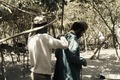 ASC Leiden - Coutinho Collection - A 02 - Surgery in Sara, Guinea-Bissau - Putting on a surgical gown - 1974.tif