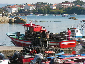 Crab fisheries - Small crab boat in harbour at A Illa de Arousa, Galicia, Spain