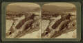 A Mountain of 'Petrified Water'- Pulpit Terrace and Mammoth Spring Hotel, Yellowstone Park, U.S.A, by Underwood & Underwood 3.png