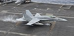A U.S. Marine Corps F-A-18C Hornet aircraft assigned to Marine Strike Fighter Squadron (VMFA) 323 lands aboard the aircraft carrier USS Nimitz (CVN 68) in the Indian Ocean June 7, 2013 130607-N-TW634-233.jpg