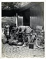 A dispatch rider (of the Indian Corps) repairing motor cycle (Merville, France). Photographer- H. D. Girdwood. (13875318684).jpg