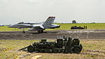 A field arresting system catches the tailhook of a U.S. Marine Corps F-A-18C Hornet aircraft as it lands at Clark Airfield, Pampanga province, Philippines, Oct. 2, 2013, during Amphibious Landing Exercise 131002-M-SO590-001.jpg