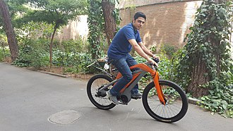 A man riding an electric bicycle A man riding an electric bicycle.jpg