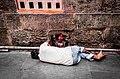 A man sleeping at Kamakhya temple.jpg