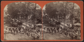 A parade with wagons, men dressed as militia and a band, by Sheldon, K. T. (King T.).png