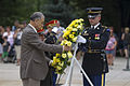 A tomb guard sentinel with the 3rd U.S. Infantry Regiment (The Old Guard) assists Afghan Army Lt. Gen. Azziz Rahman, left, the Afghan assistant minister of defense for Reserve Affairs and Lt. Gen. Azizullah 130620-A-IL196-614.jpg