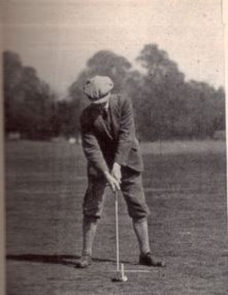 Abe Mitchell - Mitchell, c. 1911, demonstrating proper fairway wood technique – notice the white perpendicular lines drawn to show correct ball placement in the stance.