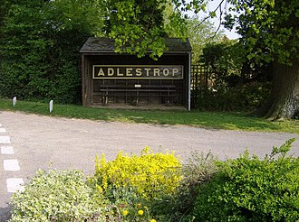 Edward Thomas (poet) - Adlestrop bus shelter with the station sign. Thomas immortalised the (now-abandoned) railway station at Adlestrop in a poem of that name after his train made a stop at the Cotswolds station on 24 June 1914