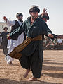 Afghan men dance during intermission at a district wrestling tournament outside of the Zhari district center, Kandahar province, Afghanistan, Dec 111224-A-VB845-362.jpg