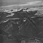 Aialik and Pederson Glaciers, tidewater glacier terminus with icefield and icefall in the background, September 4, 1977 (GLACIERS 6761).jpg