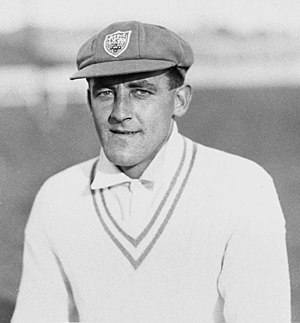 Cricket clothing and equipment - Australia Test Cricketer Alan Fairfax wearing the traditional white sweater and the NSW XI cap.