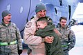 Alaskan Guardsman hugs his son after returning home from Afghanistan (4228420422).jpg
