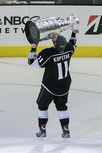 Anže Kopitar - Kopitar celebrates with the Stanley Cup, after the Kings won the 2012 Stanley Cup Final.