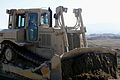 An Afghan National Army soldier with Horizontal Tolai, Engineer Kandak, 201st Corps bulldozes earth around the site of a new yard planned for Forward Operating Base Gamberi in Laghman province, Afghanistan 131111-A-CB167-101.jpg
