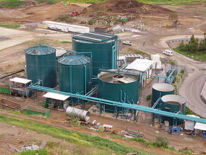 Anaerobic digestion - Left: Farm-based maize silage digester located near Neumünster in Germany, 2007 - the green, inflatable biogas holder is shown on top of the digester. Right: Two-stage, low solids, UASB digestion component of a mechanical biological treatment system near Tel Aviv; the process water is seen in balance tank and sequencing batch reactor, 2005.