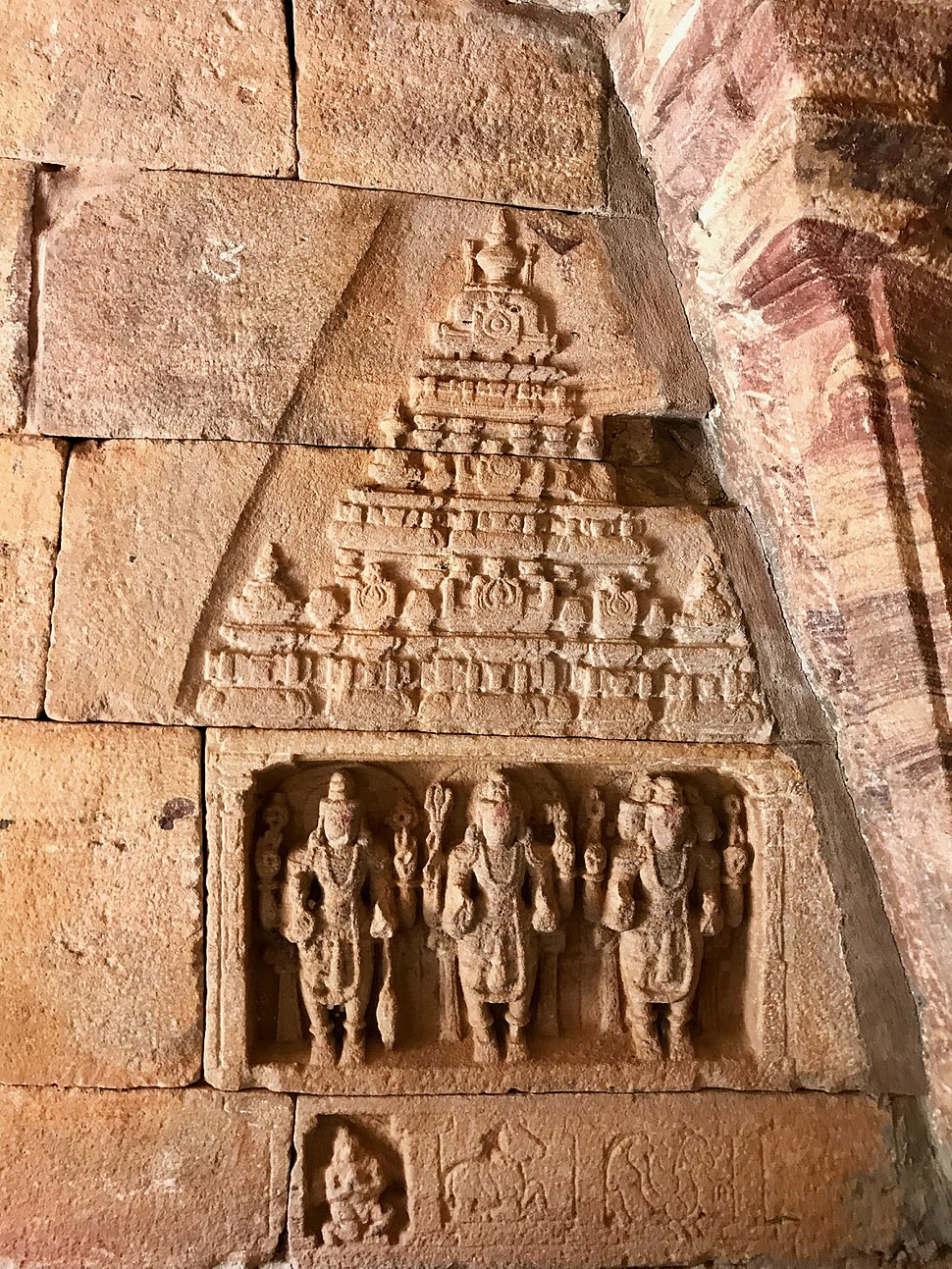 Vishnu, Shiva and Brahma in a small rock carving monument