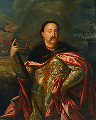 Portrait of John III Sobieski in Polish costume with the battle in the background.