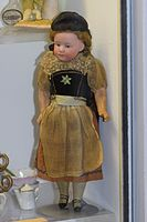Antique German doll in traditional costume (25482797535).jpg