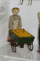 Antique toy wind-up apple peddler (25066214726).jpg