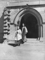 Archibishop of Brisbane Dr. John Wand leaving St. Johns Cathedral after service on ANZAC Day 25 April 1937.tiff