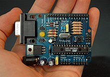 A 3rd-party Arduino board with a RS-232 serial interface (upper left) and an Atmel ATmega8 microcontroller chip