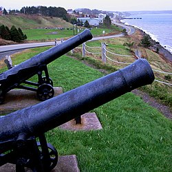 The island community of Arichat, Isle Madame, Nova Scotia as seen from Cannon Look-Off. These cannons commemorate the eighteenth century period of the community's long history.