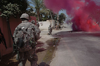 Diyala campaign - Soldiers from the 5th Iraqi Army Division, run through a smoke screen in Baqubah, Iraq, June 22, 2007, as Soldiers from the 3rd Stryker Brigade Combat Team, 2nd Infantry Division follow.
