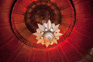 Castro Theatre - The extravagant interior ceiling of the Castro Theater and Art Deco chandelier made by Phoenix Day Lighting, as it appears in the darkened movie hall.