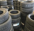 Assorted stacked automotive tires.jpg