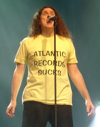 """You're Pitiful - Weird Al wearing his """"Atlantic Records Sucks"""" shirt during a performance of """"You're Pitiful"""", on August 8, 2007, at the Ohio State Fair."""