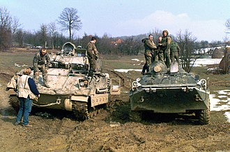 BTR-80 - A BTR-80 alongside a Bradley Fighting Vehicle in Bosnia during Operation Joint Endeavor.
