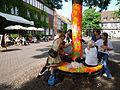 Ballhofplatz Hannover Bekleben eines Baumes und einer Sitzbank im Rahmen der Schwarmkunstaktion Strich-Code.jpg