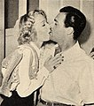 Betty Hutton kisses her first husband Ted Briskin, 1949.jpg
