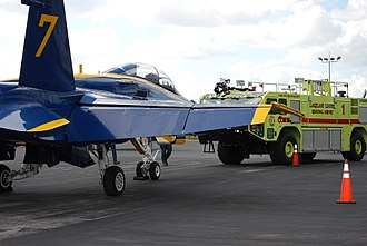 Lakeland Linder International Airport - ARFF 1 and USN Blue Angel 7 sit in front of the terminal