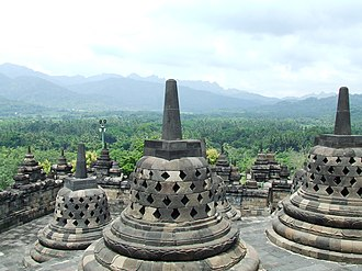 Mahayana - Ancient Buddhist stūpas in Borobodur, Indonesia.